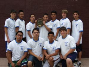The 2010 St. Francis Prep J.V. Team gathers together to display their CHSAA City Championship plaque after defeating Loughlin 3 - 0 on May 17, 2010. This is the sixth consecutive undefeated City Championship and the seventh consecutive championship for the SFP J.V. Team.